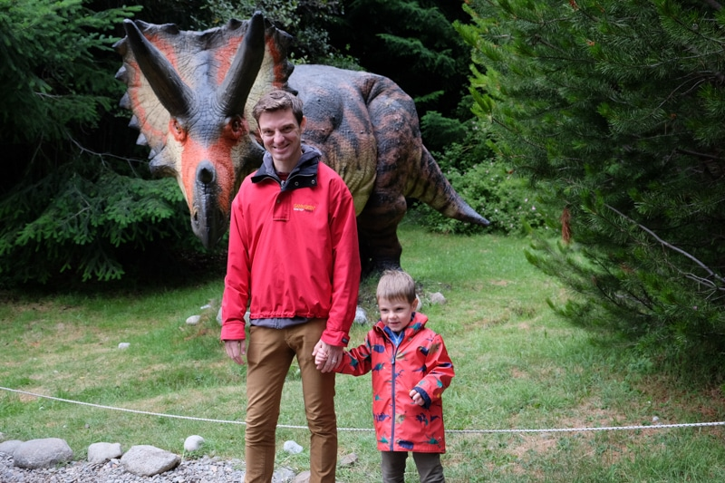 father and son in dinosaur park in argentina
