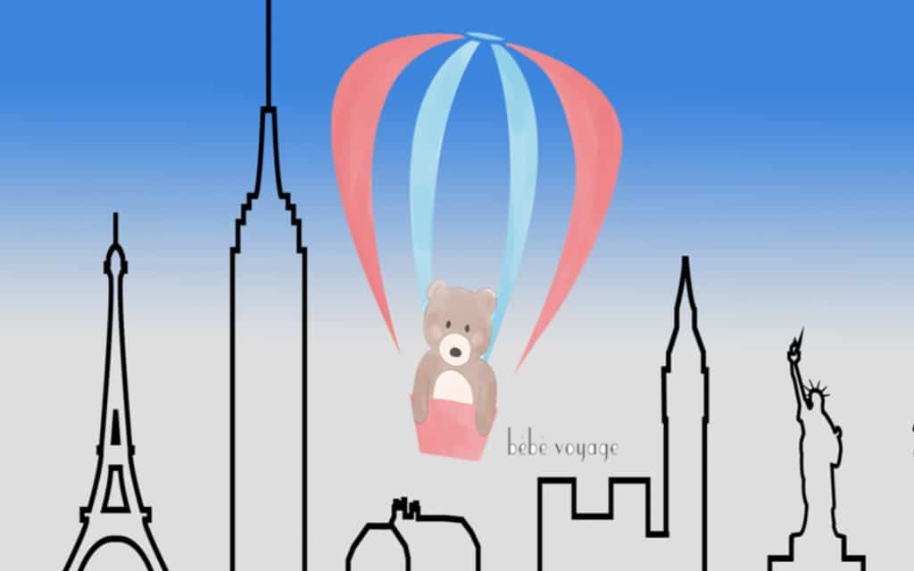 illustrated skyline with hot air balloon and teddy bear
