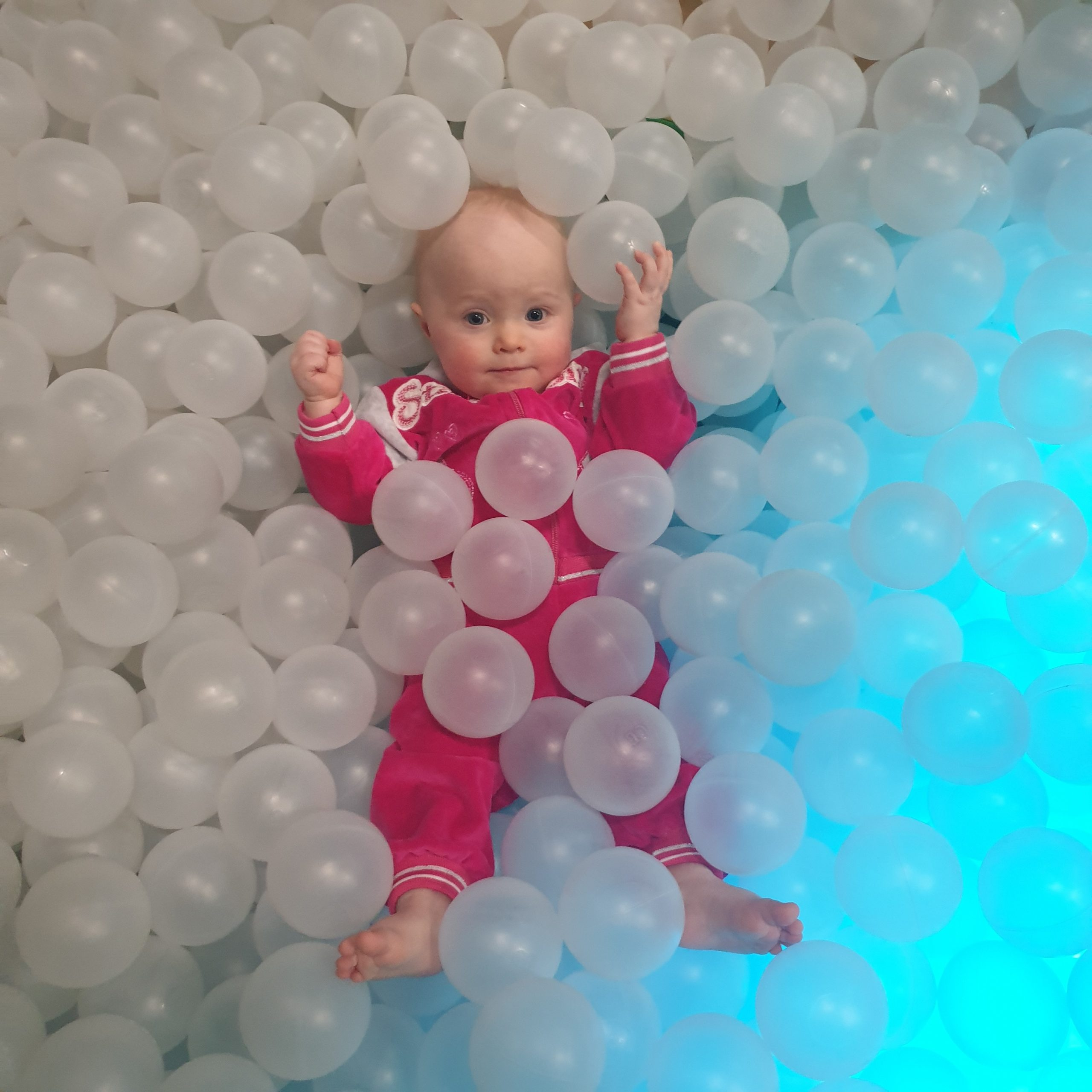 baby enjoys the family-friendly day in helsinki by playing in the ball pit