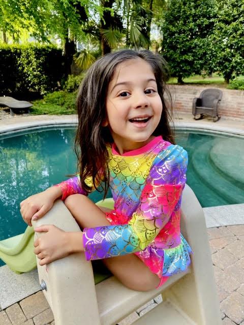 little girl in swimming pool