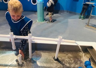 Small child playing with an interactive water exhibit