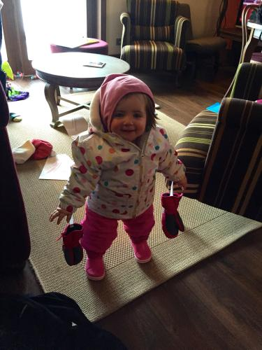 toddler in ski clothes