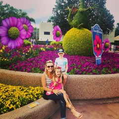 Pri and her kids sitting on a bench during their family-friendly Orlando day