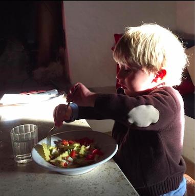 Toddler eating pasta in Italy