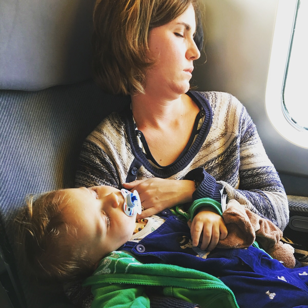 Mommy and baby passed out on the train to the Alps after the plane. He is holding onto his new Curious George doudou. Little does he know at this point that Doudou is back home across the Atlantic.