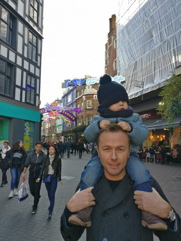Carnaby Street in London with a toddler during the Christmas season.