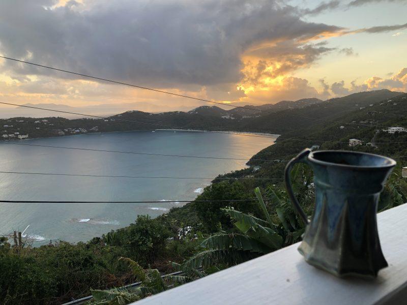 Coffee watching sunrise over bay