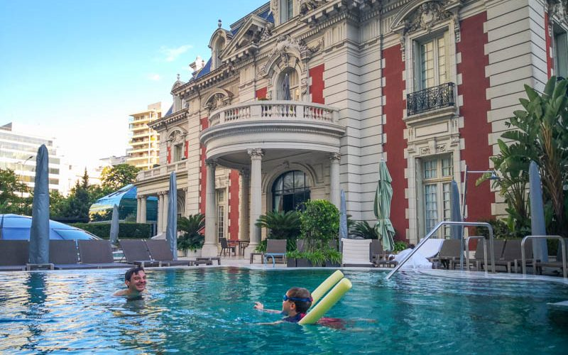father and son swimming in buenos aires hotel swimming pool
