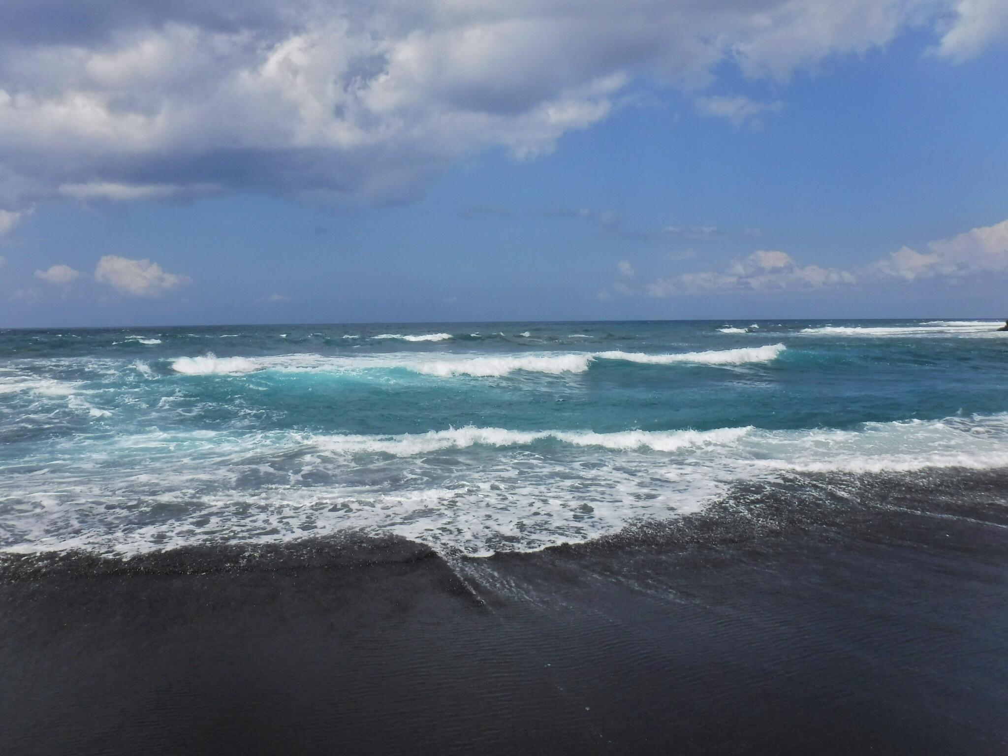 Bali, Indonesia on Cucukan's black sand beach