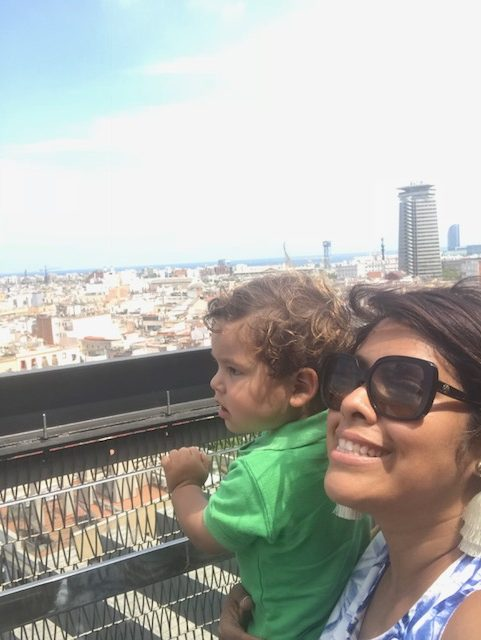Toddler boy and mother enjoying the view at Terraza 360 in Barcelona, Spain