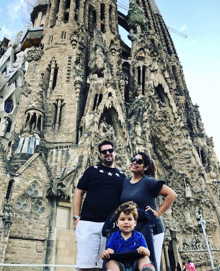 Family in front of the Sagrada Familia in Barcelona, Spain
