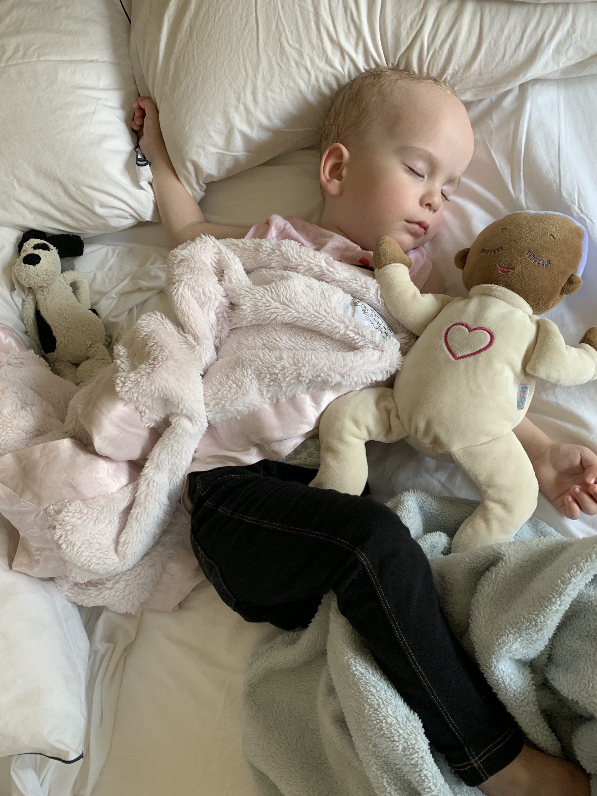 Esmé taking a nap with her Lulla Doll