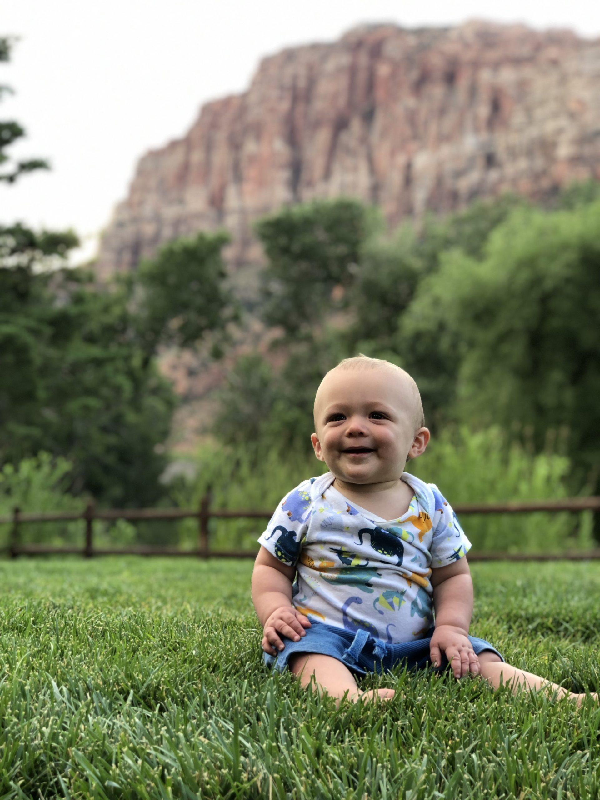 Baby sitting on field