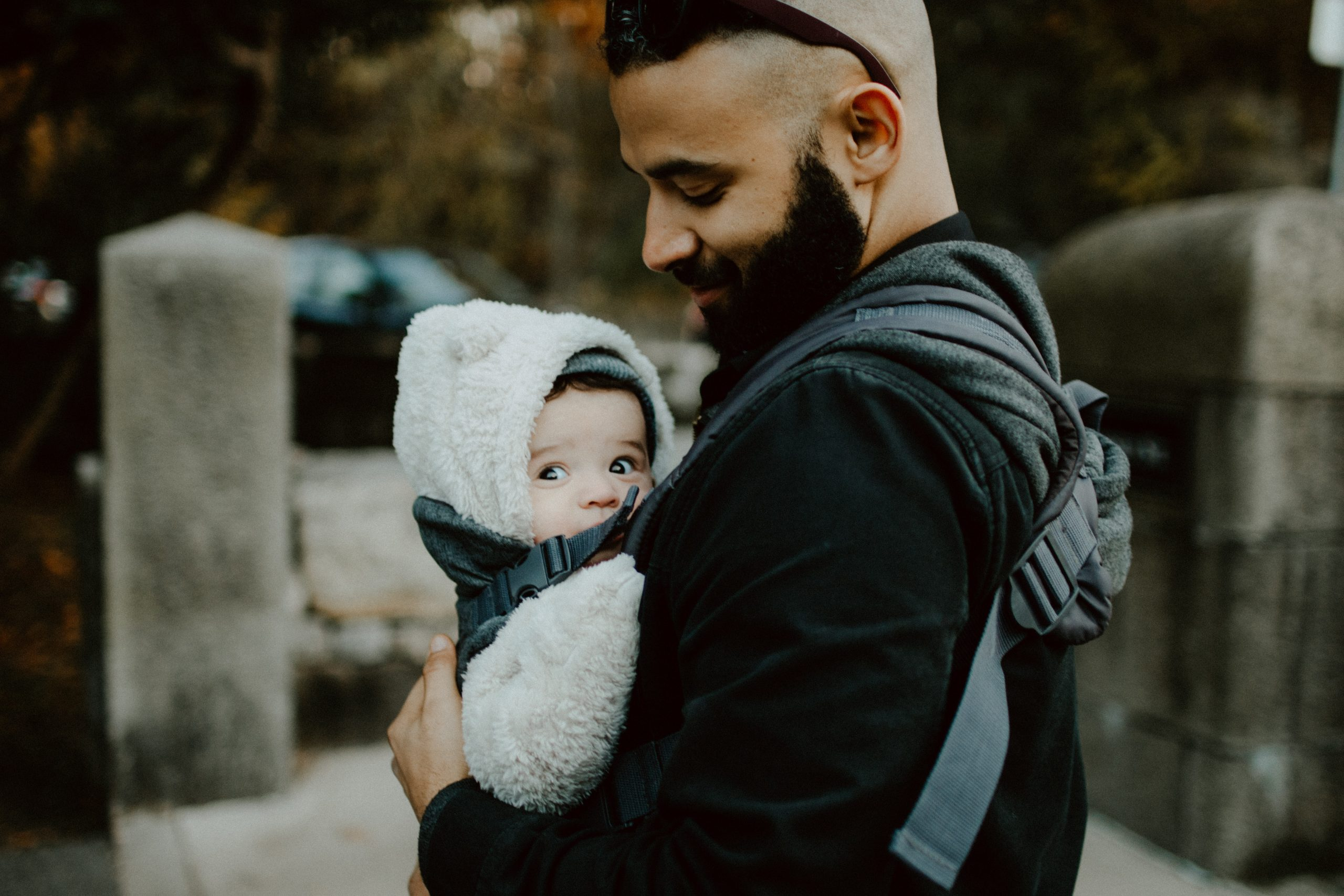 father and baby in baby carrier