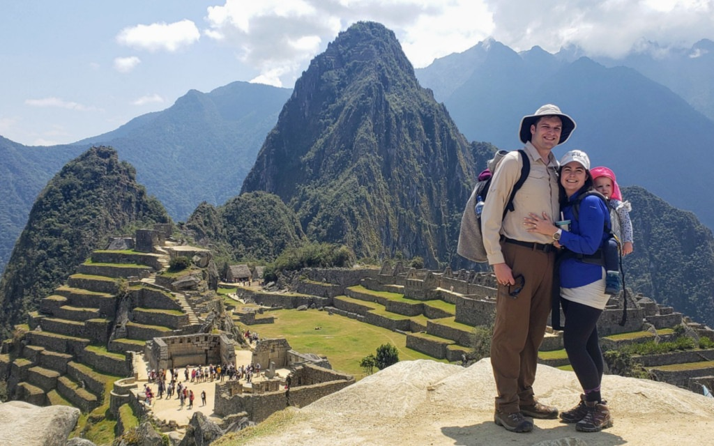 family with toddler in front of machu picchu
