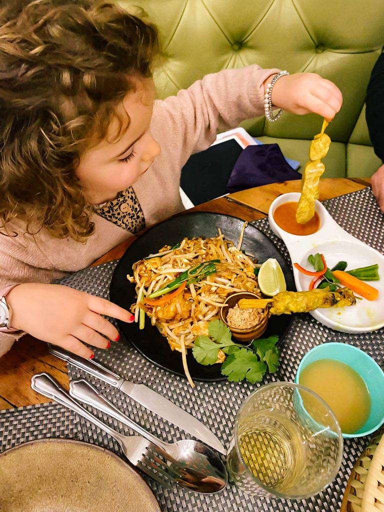 Researching restaurants ahead of time is a great way to enjoy a healthy family vacation.