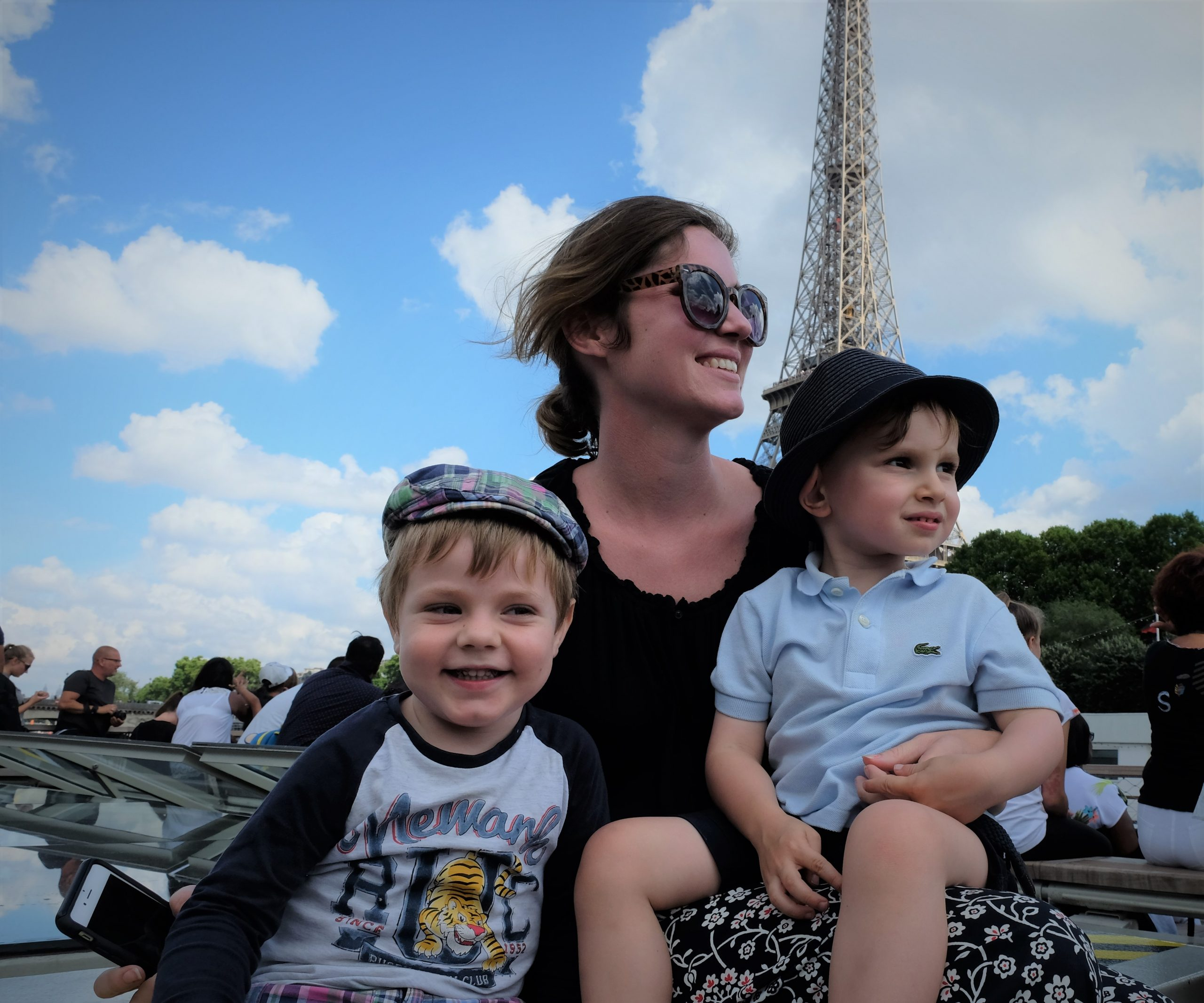 Mother and kids in front on river Cruise Paris Seine Eiffel Tower
