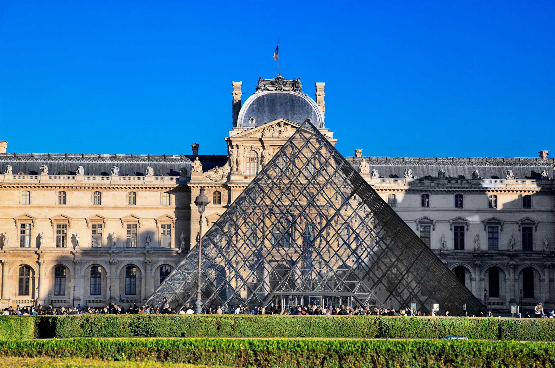 View of one of the glass pyramids at the Louvre in Paris, France