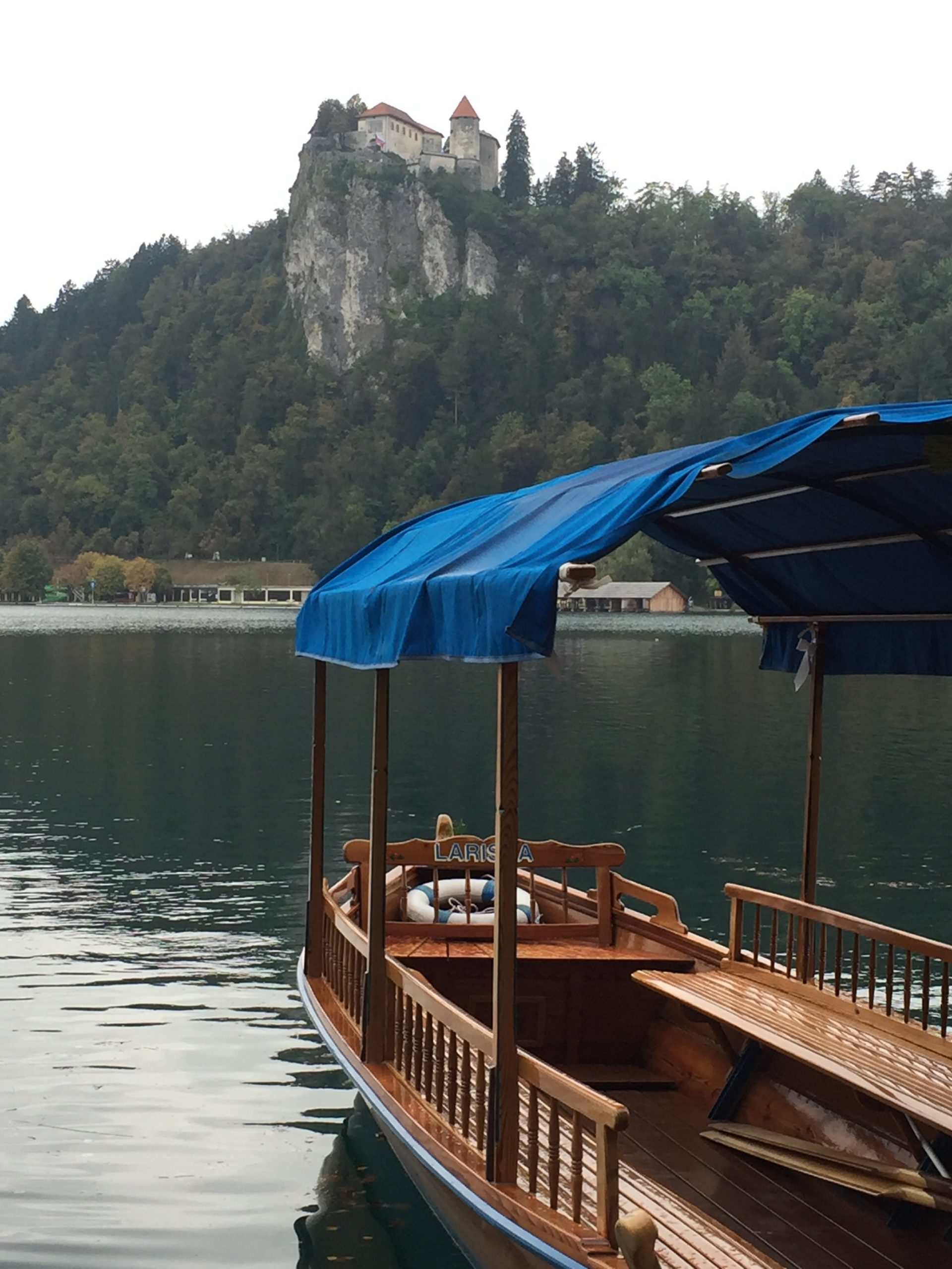 A view of Lake Bled in Slovenia with a docked boat