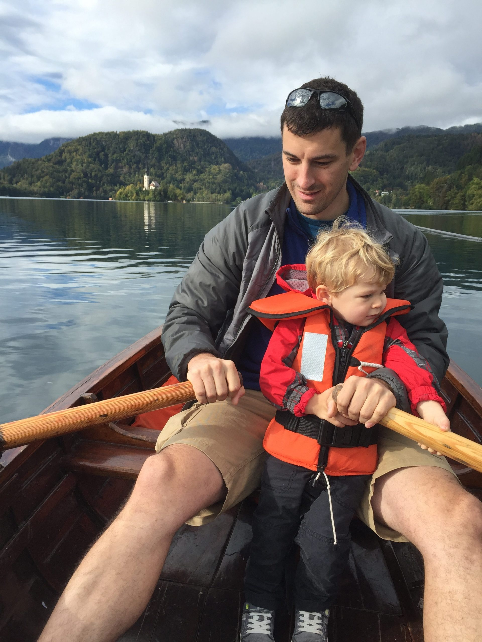 Father and Son Rowing a Boat on Lake Bled