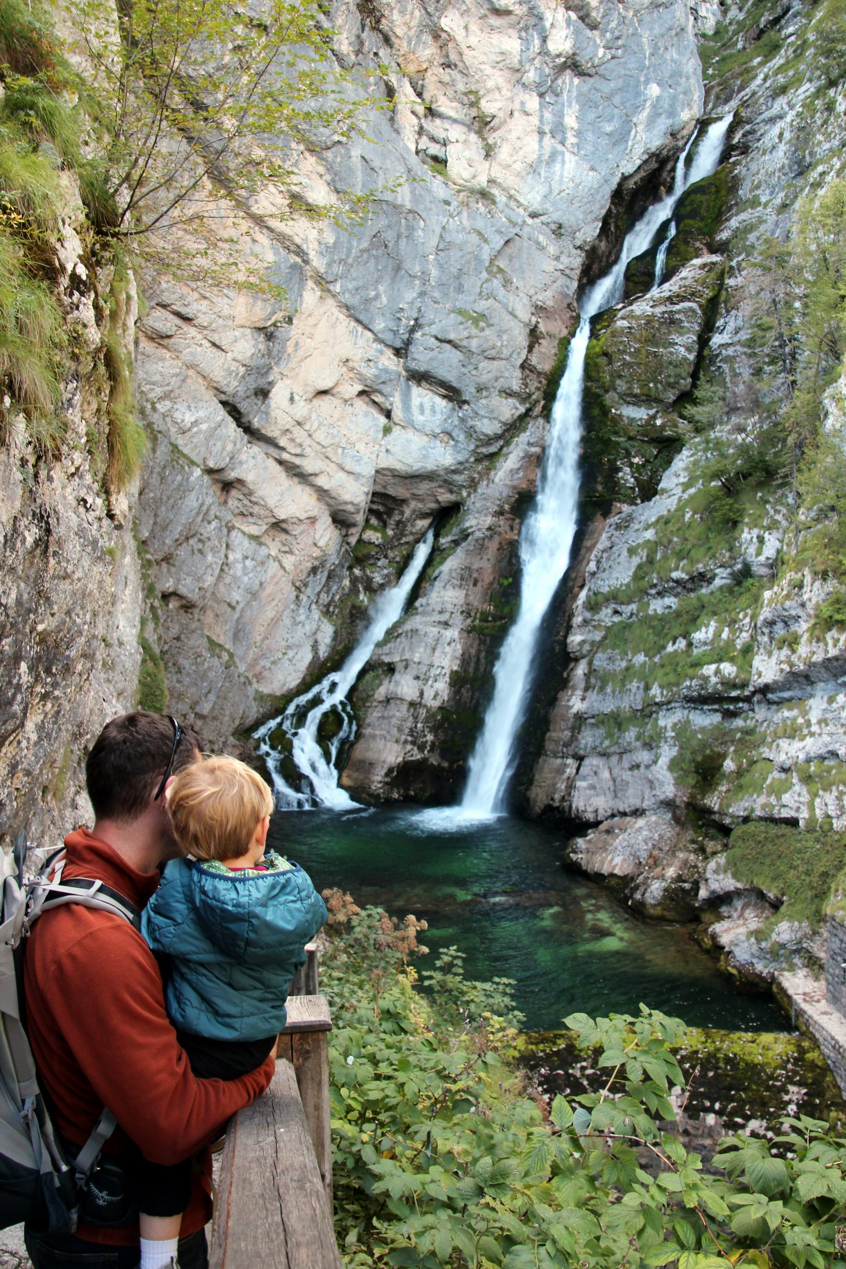 Father and Son taking in A View of Slap Savica waterfall in Slovenia