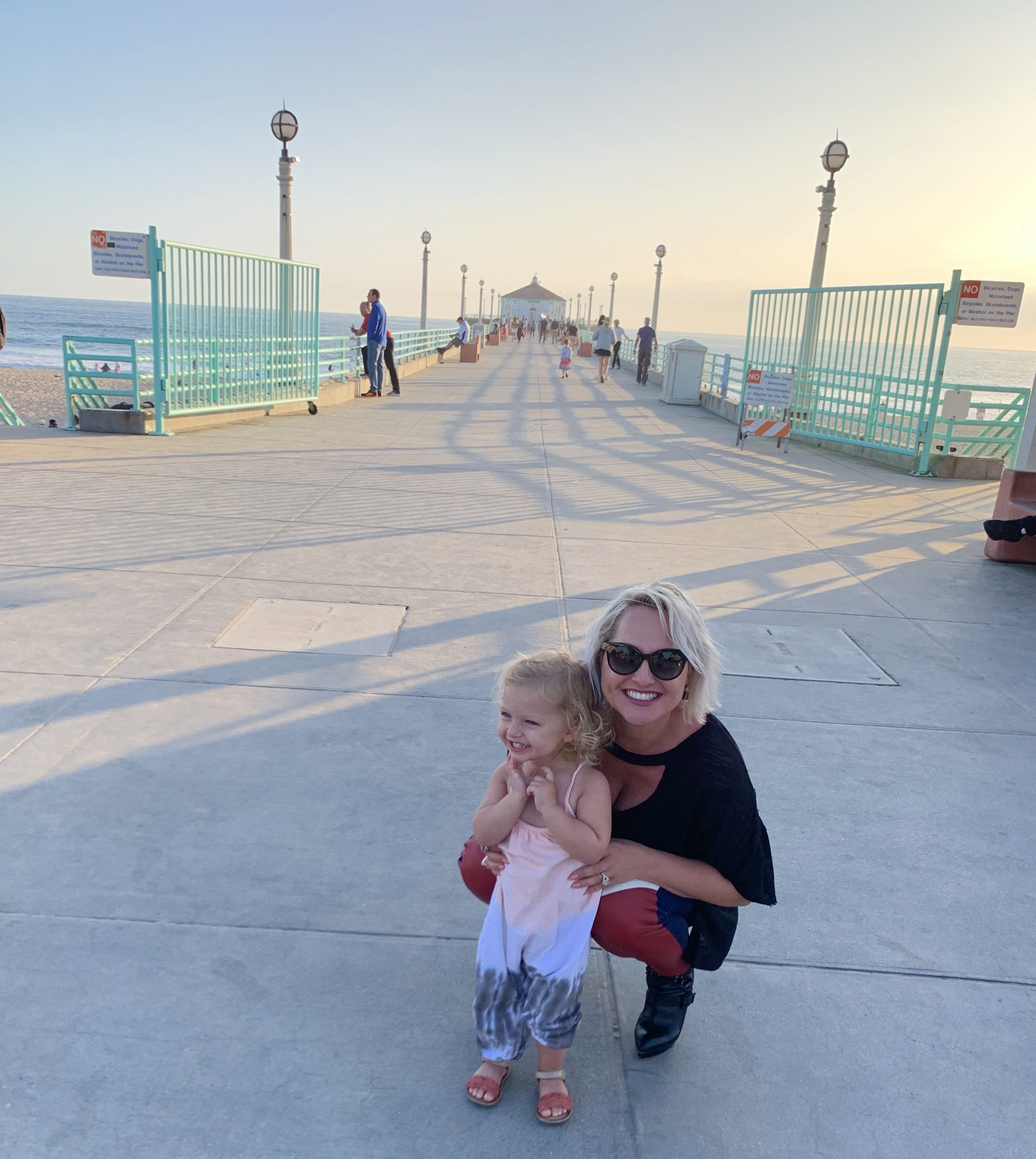 Rebecca with her kid during their family-friendly day in Manhattan Beach