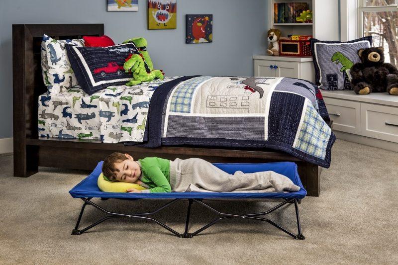 portable sleep cot in bedroom