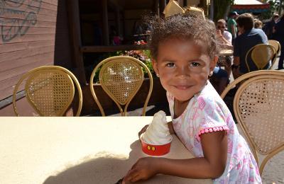 Eating a Dole Whip at Aloha Isle at Magic Kingdom