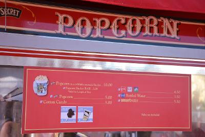 Popcorn and drink options at a Disney food cart