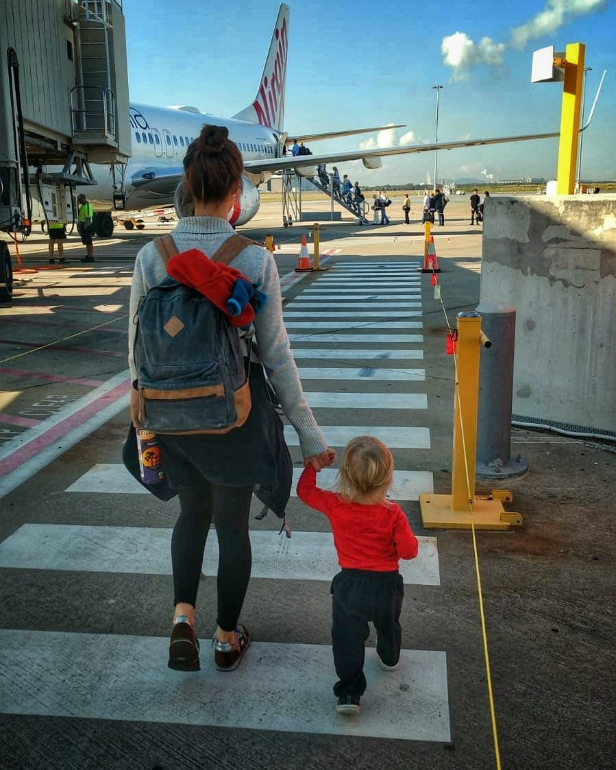 mother and child boarding a plane