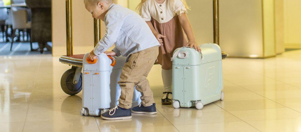 2 kids with jetkids bedbox in hotel lobby