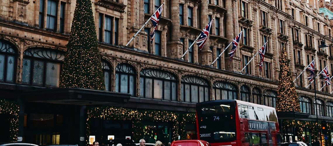 christmas at harrods in london with lights and christmas trees and london bus