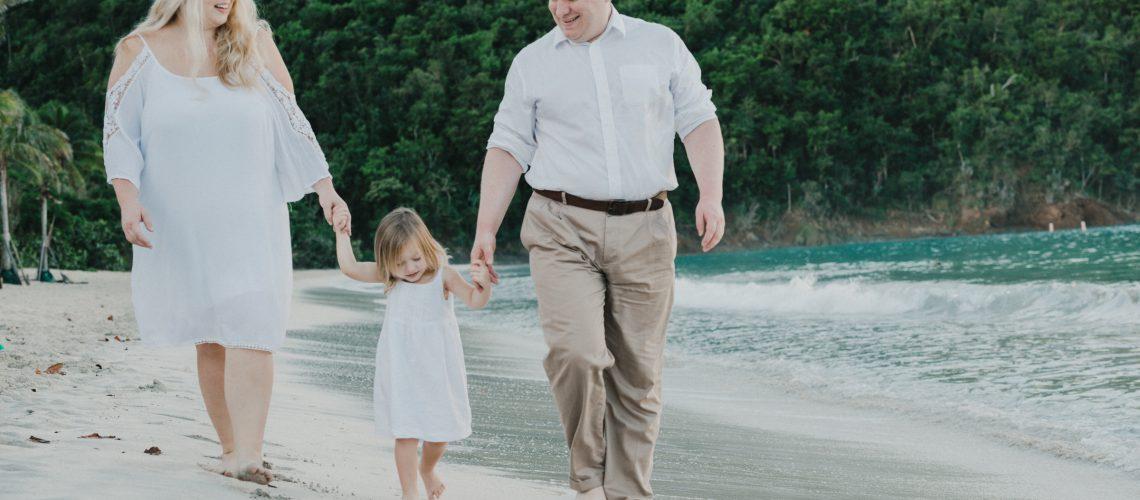 family in st thomas walking on beach