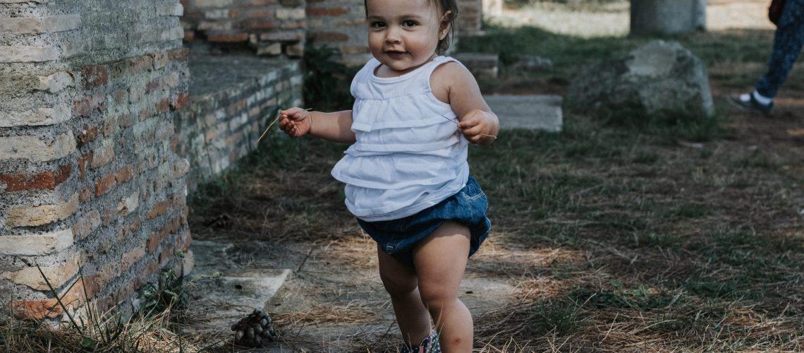 baby walking alone in Ostia Antica